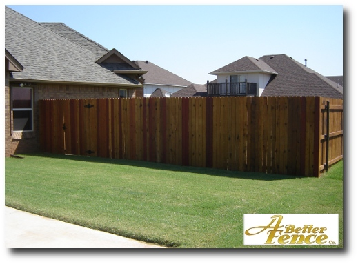 Stained solid board fence design, with cedar pickets