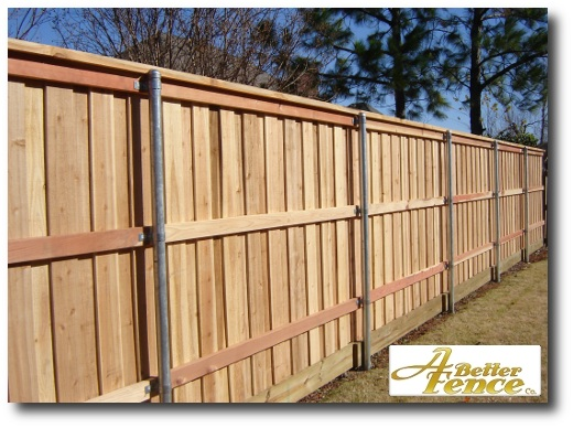 Decorative absolute privacy fence with trim, backside