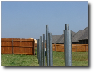 Badly installed galvanized fence post.