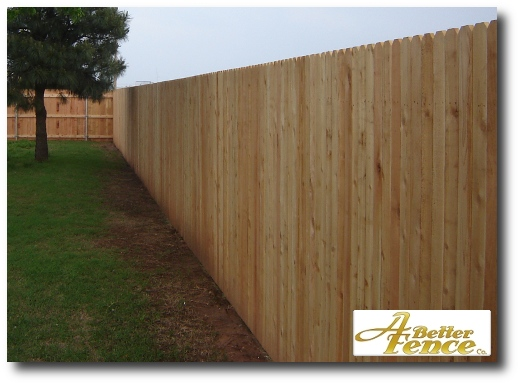 An unstained solid board fence