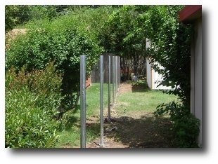 Staight in line galvanized fence post.