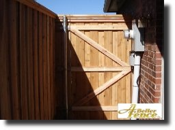 Decorative privacy fence inside view of gate