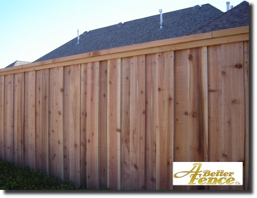 Decorative privacy fence with full trim, including cedar top cap and cedar 1x2 trim piece